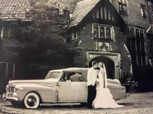 MR AND MRS IN FRONT OF CAR